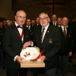 ECMVC Chairman, Ian Hardy, receives a gift of a commemorative plate from Beaufort Male Choir